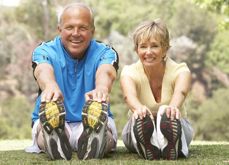 senior couple stretching for better health